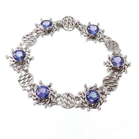 18k white gold infinity twist diamond tanzanite textured disc link bracelet