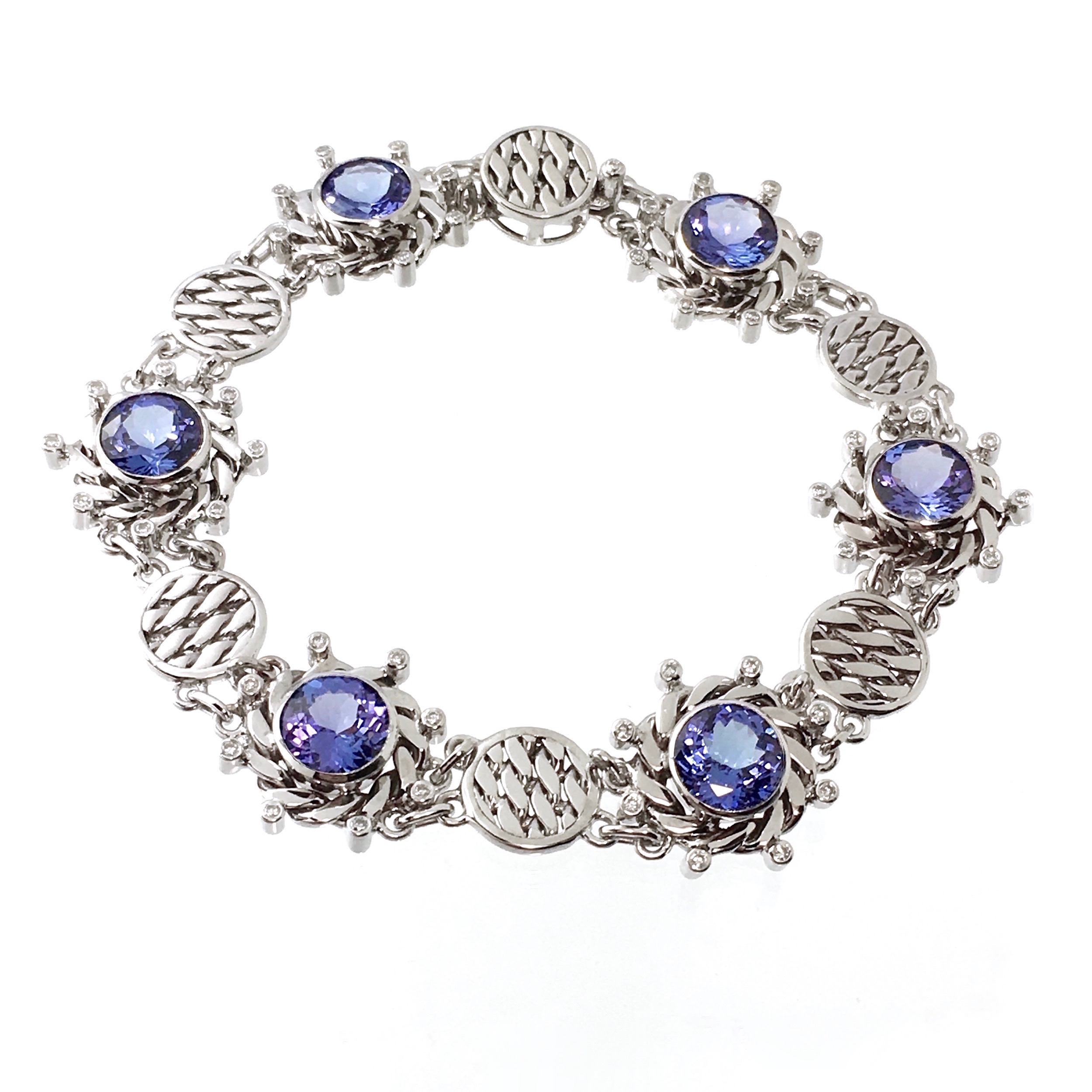 18k white gold infinity twist diamond tanzanite textured disc link bracelet