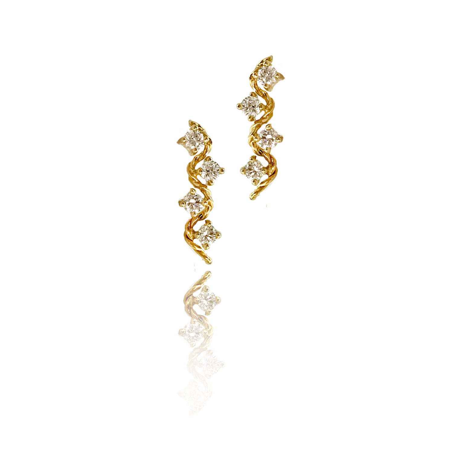 18k Gold Diamond Twist Wave Enlace Stud Earrings combine prong set diamonds with Jewelyrie's signature touch of Pirouette Twist.