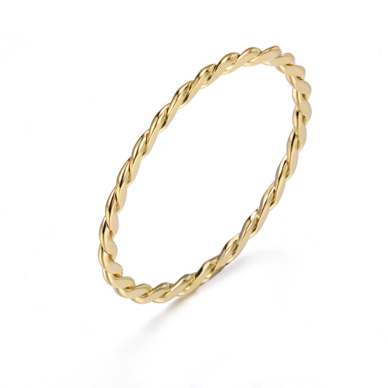 JeweLyrie Signature Gold Slim Twist 0.8mm band Ring Guard Spacer, makes statement from subtle to dashing, available in 14k and 18k by JeweLyrie.