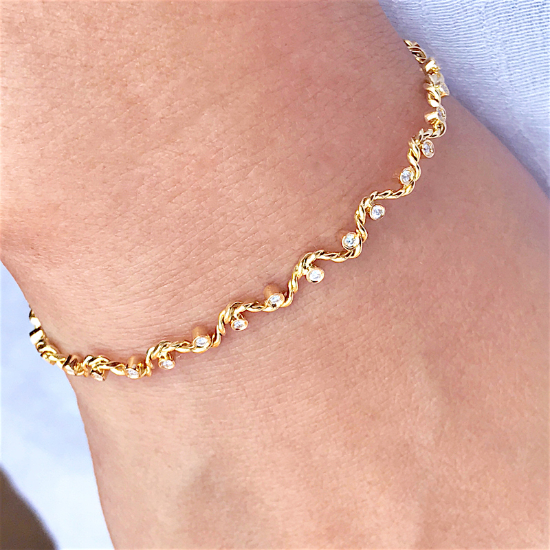 Snug Fit Signature Wavy Twist Ribbon Scattered Diamond Open Gold Stacking Cuff in 14k and 18k with total 0.245ct white diamonds by JeweLyrie