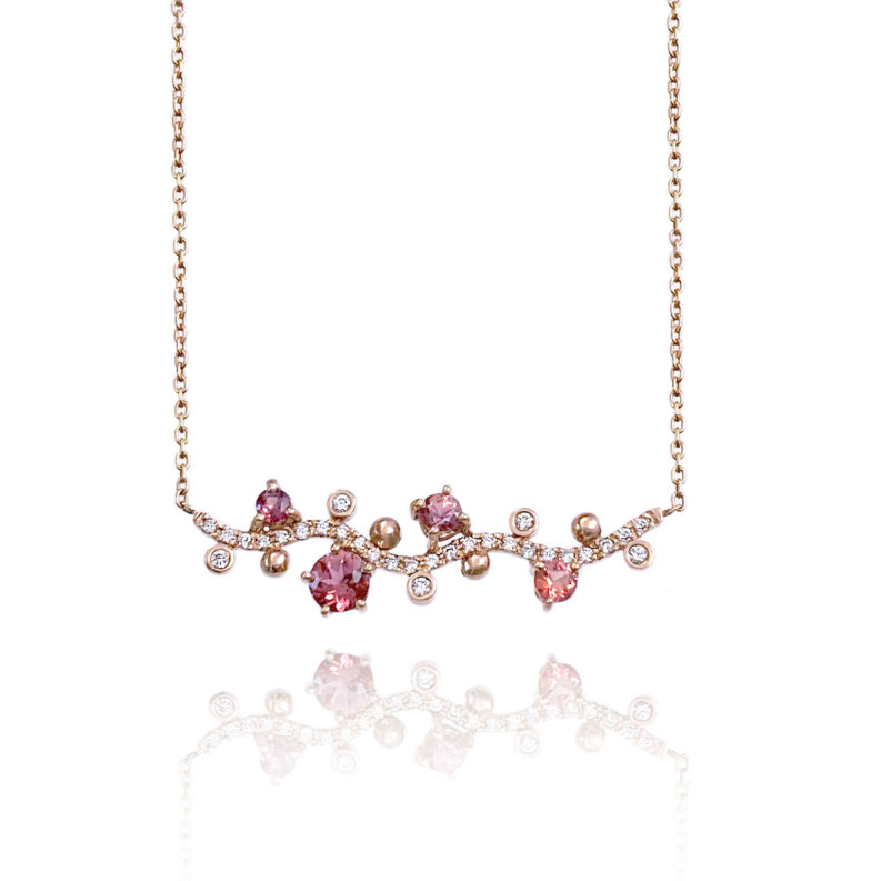 Pink Floral Vine Pendant Necklace with peach and pink sapphire, spinel and white diamonds scattered along sides of Pavé diamond wavy bar