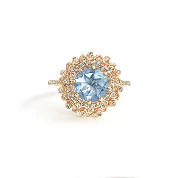 Soothing blue topaz ring wrapped with double halo set with 44 diamonds by JeweLyrie