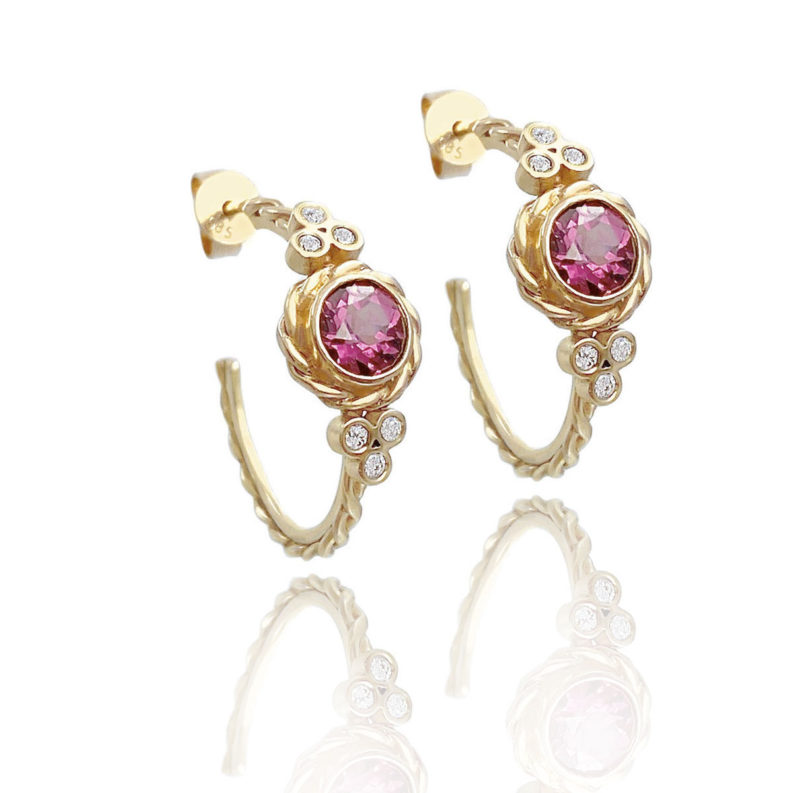 Lined twist earrings showcasing bezel set rhodolite garnet wrapped with signature twist and flanked with diamond trio clusters by JeweLyrie