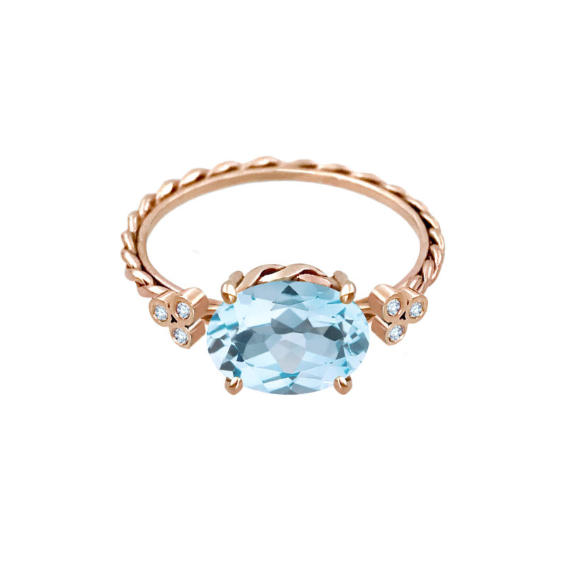 East-west oval sky blue topaz and diamond ring with signature twist setting and shank handcrafted in 14k and 18k made to order by JeweLyrie free domestic shipping