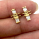 18k-Gold-Flank-Baguette-Diamond-Twist-Stud-Earrings-from-Jewelyrie-by-Huan-Wang-TUTh